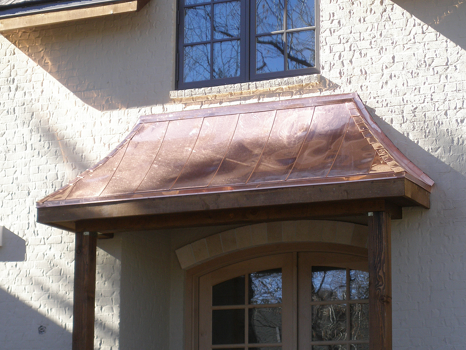 Flat seam copper veneer roof