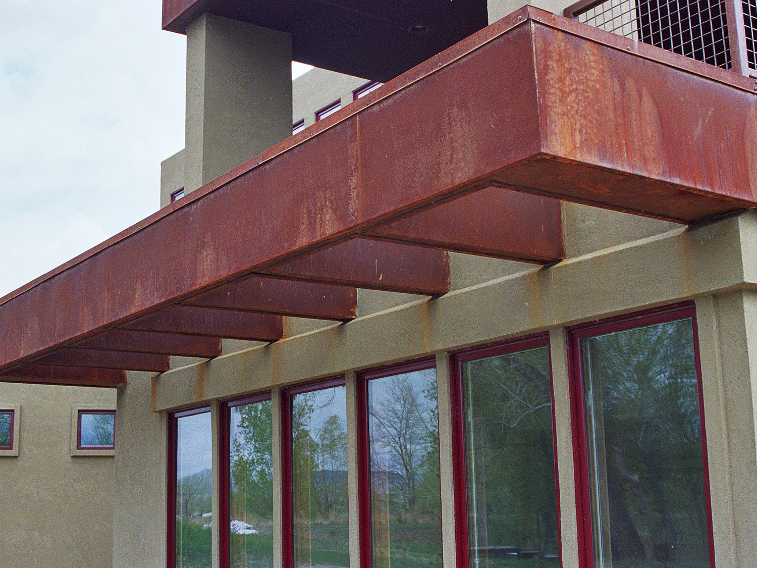 Copper standing seam with cold rolled steel veneer sun shades
